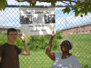 Adam and Dolores Hang the Garden Sign!